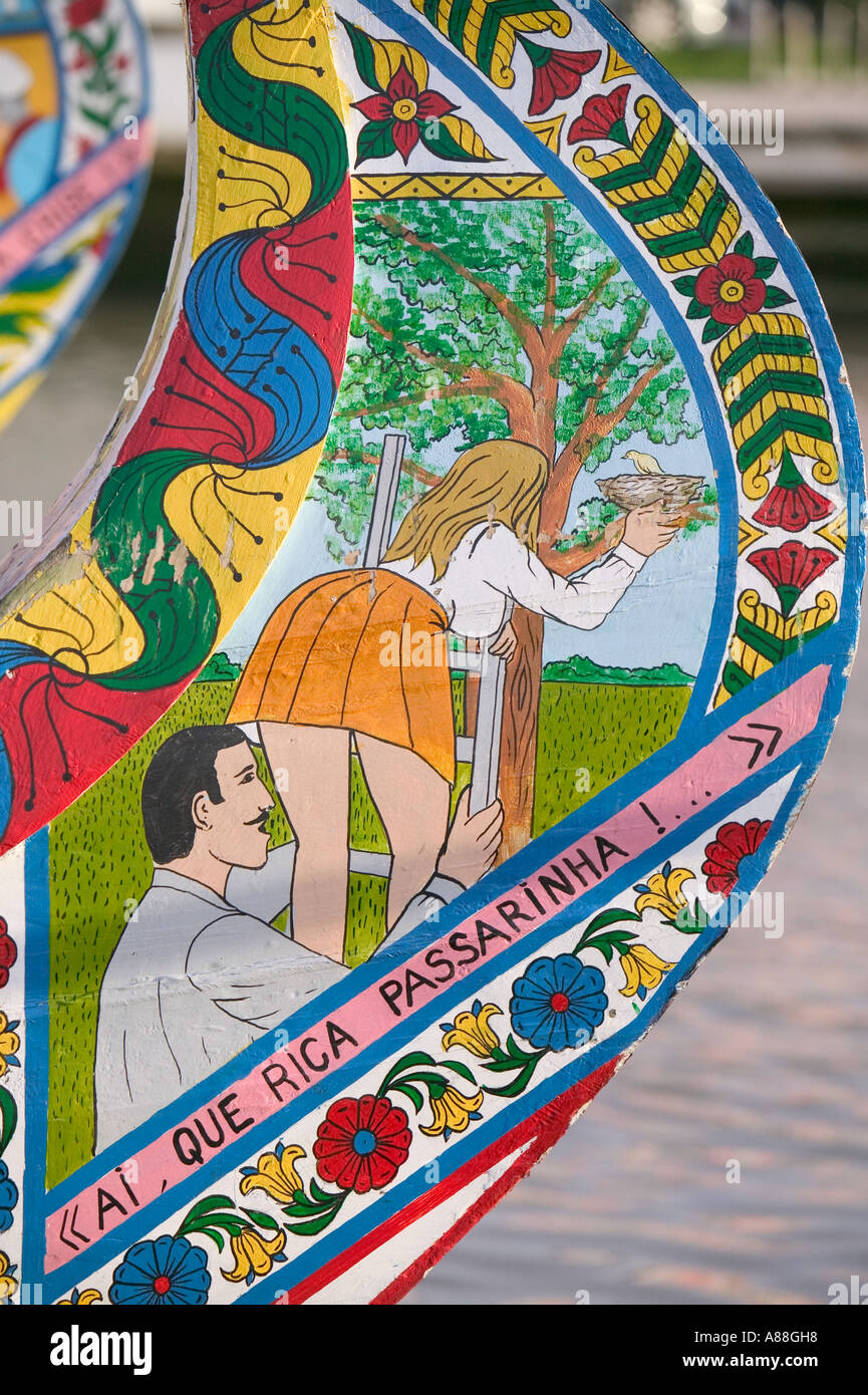 hand painted designs on Moliceiro fishing boats on a canal in Aveiro, Portugal - Stock Image