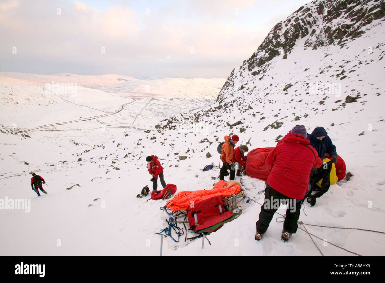 a lakeland rescue team rescue an injured female fallen casualty, Red Screes, Cumbria - Stock Image