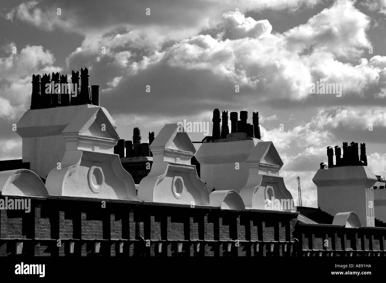 BW Edwardian houses roof tops architecture, with cloudy  sky background, Central London, Great Britain, UK, England, Europe, EU - Stock Image
