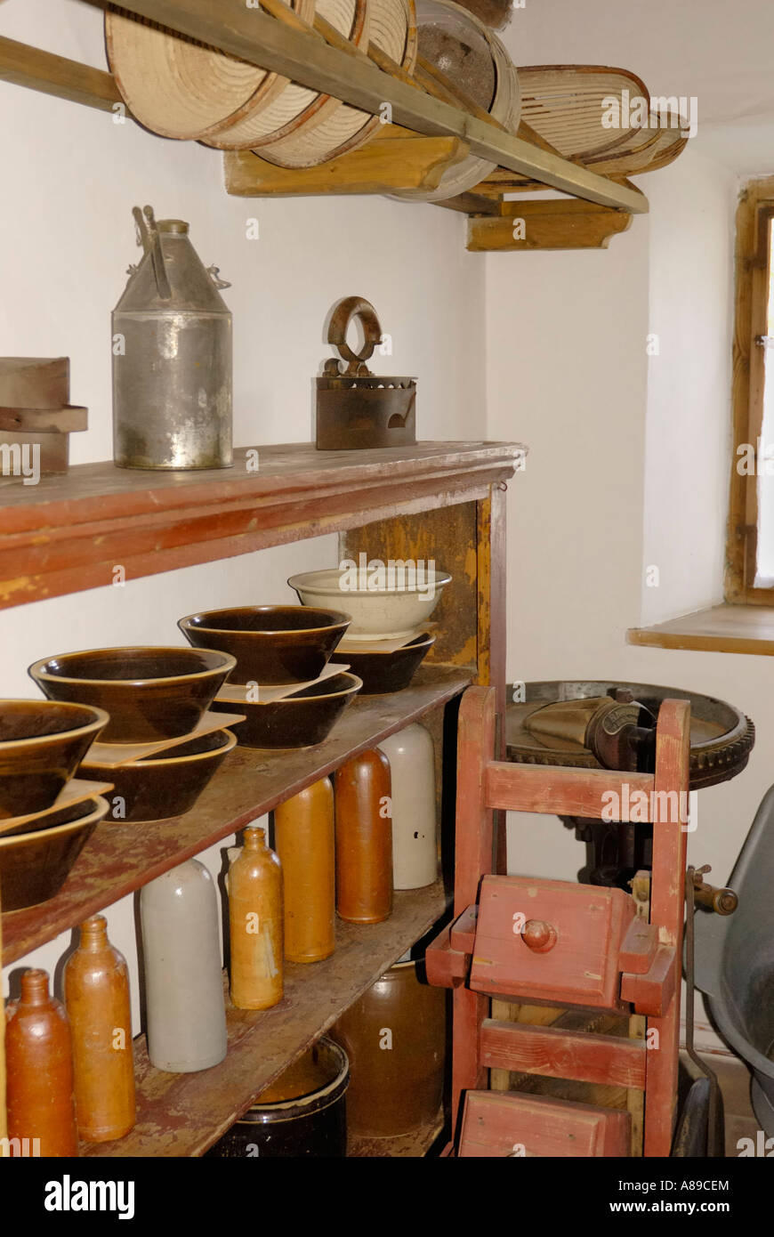 Display of old earthen dishes and vessels in the pantry of old framhouse, farmhouse museum, Amerang, Germany - Stock Image