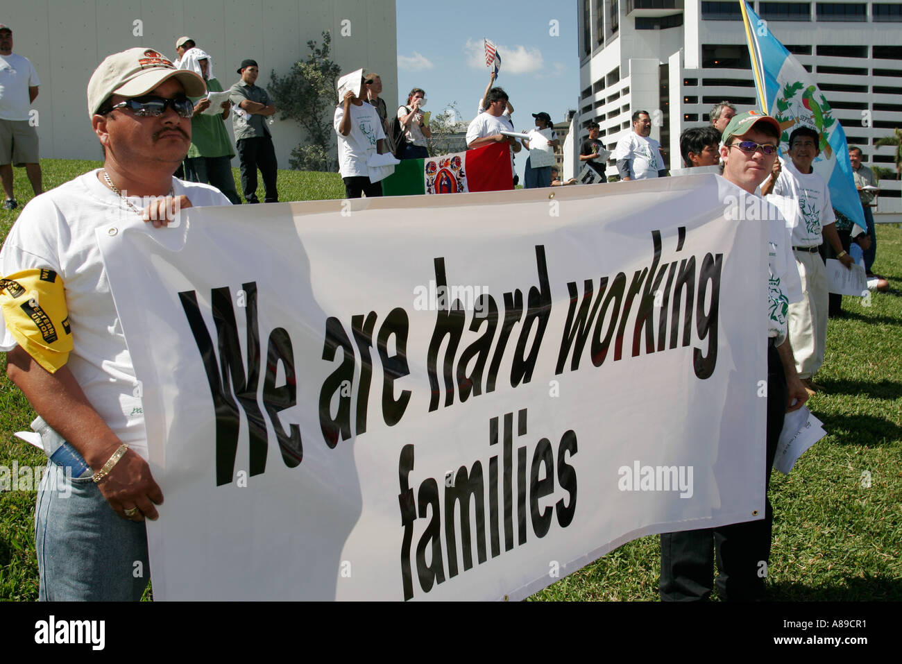 Miami Florida Bayfront Park Immigrants Rights Protest Hispanic Men Sign We Are Hard Working Families