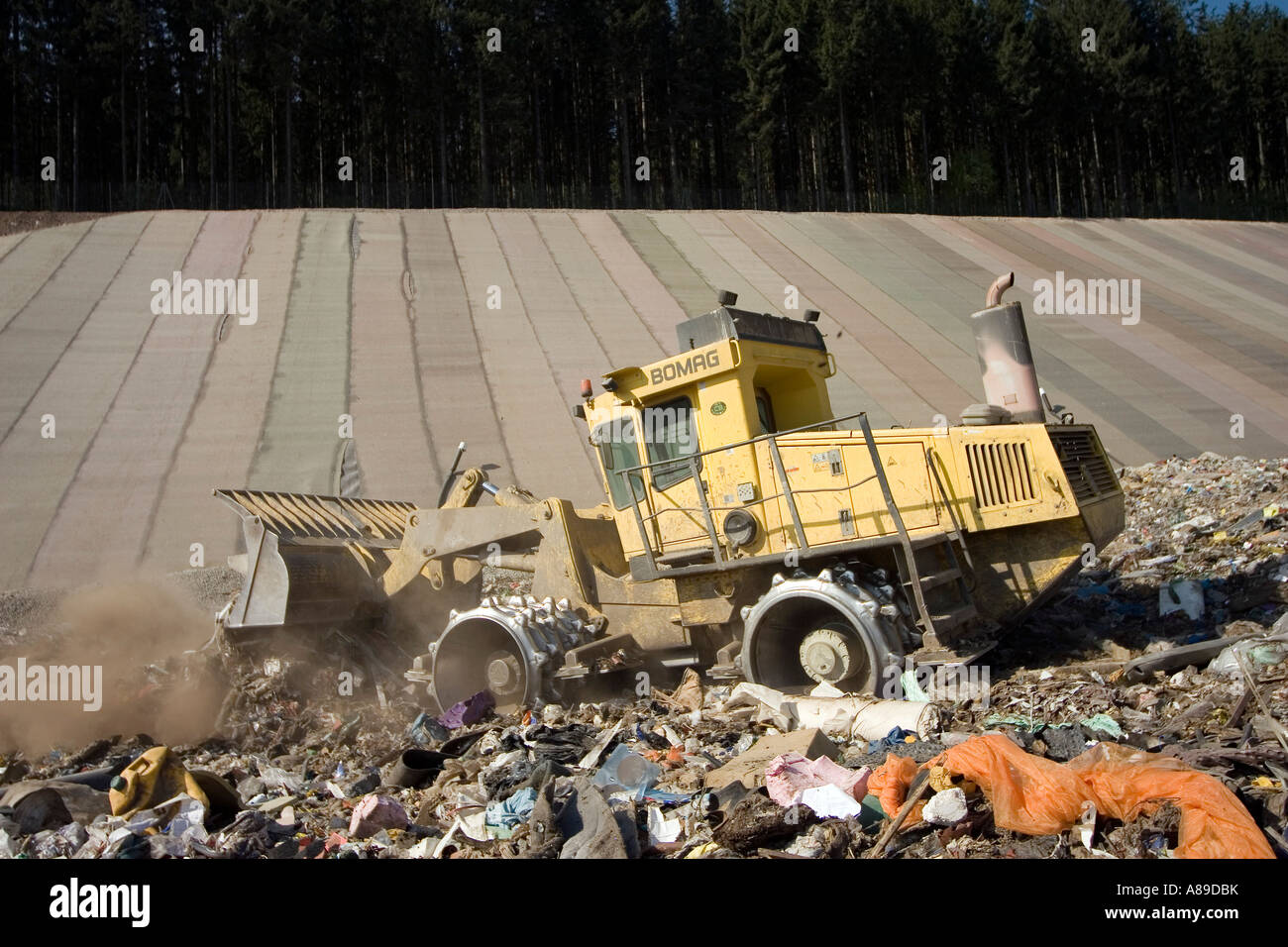 Waste and garbage truck at disposal site Riederberg, Woergl, Tyrole, Austria - Stock Image