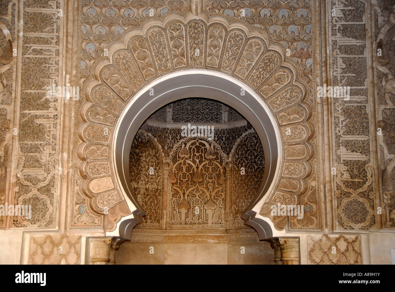 Oriental detail of with fine stucco richly decorated mihrab Medersa Ali Ben Youssef medina Marrakech Morocco Stock Photo