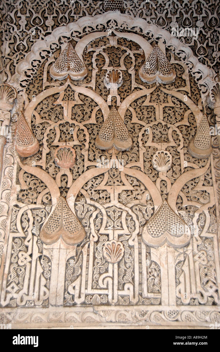 Oriental detail of with fine stucco richly decorated mihrab Medersa Ali Ben Youssef medina Marrakech Morocco - Stock Image