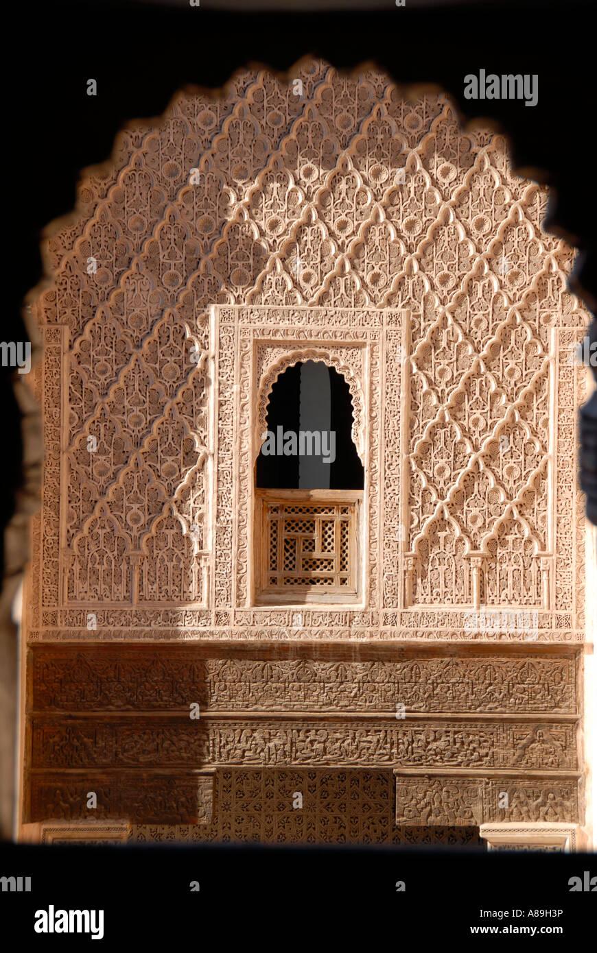 Oriental window with fine stucco richly decorated Medersa Ali Ben Youssef medina Marrakech Morocco Stock Photo