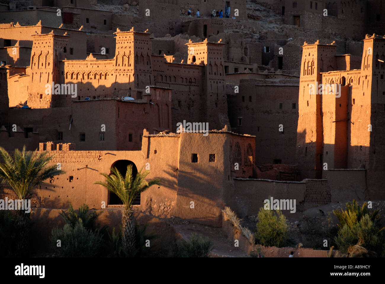 Evening light touches some buildings traditional Berber architecture Kasbah Ait Benhaddou Morocco - Stock Image