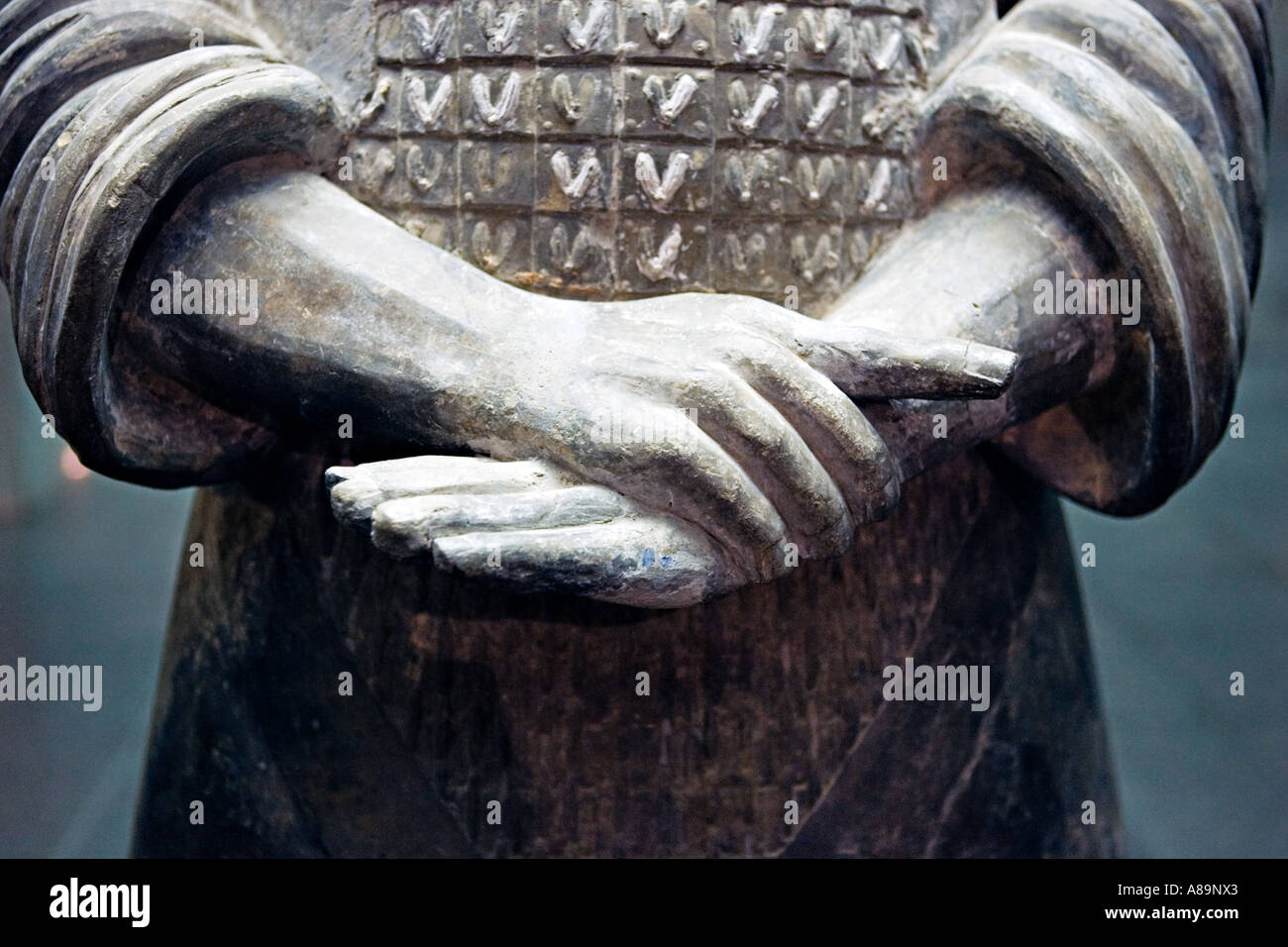 CHINA XI AN Detail of hands fingernails and chain mail armor of terracotta warrior at the Army of Terracotta Warriors - Stock Image