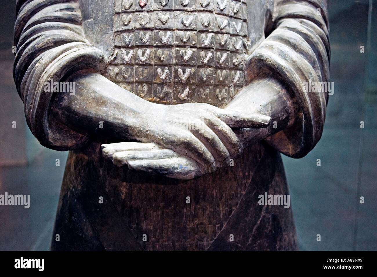 CHINA XI AN Detail of hands fingernails and chain mail armor of terracotta warrior in the museum at the site of - Stock Image