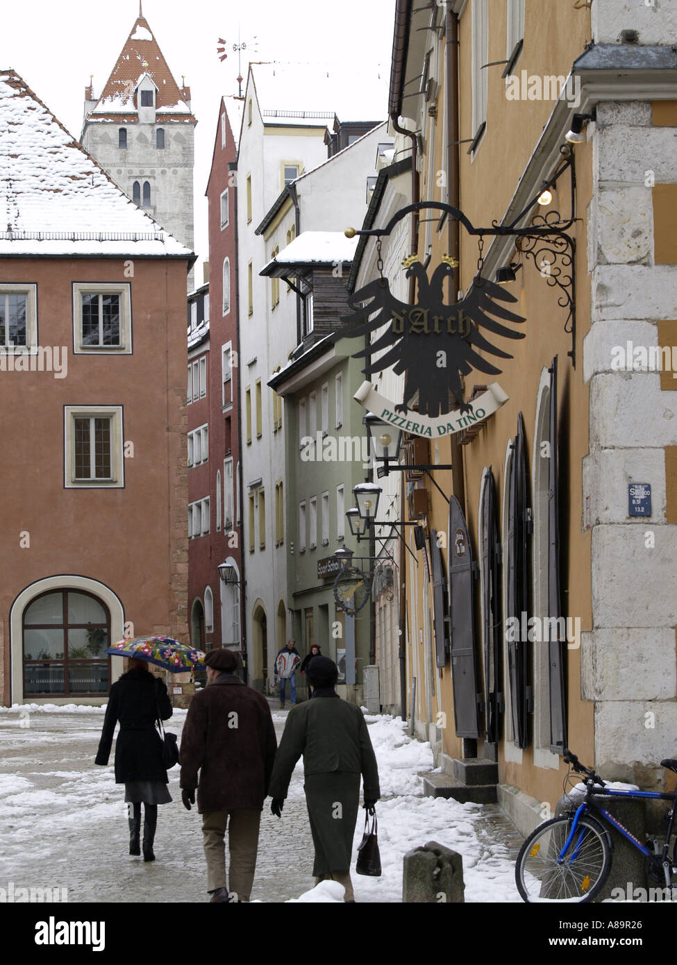 passers-by in the Old Town of Regensburg - Stock Image
