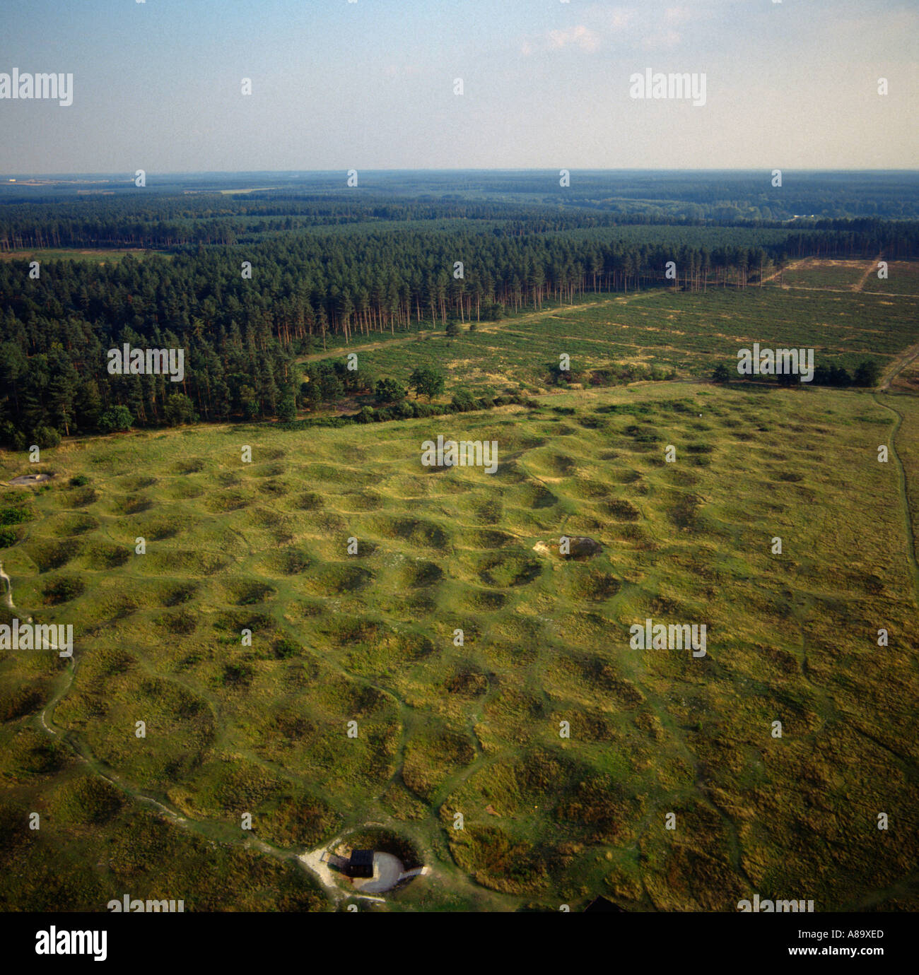 Grimes Graves neolithic flint mines Norfolk UK aerial view - Stock Image