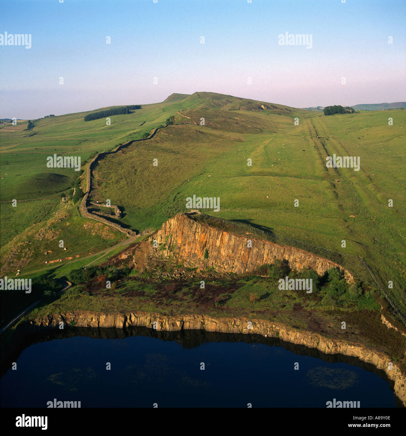 Cawfields milecastle Hadrian s Wall with Vallum defensive ditch on right Northumberland UK aerial view - Stock Image