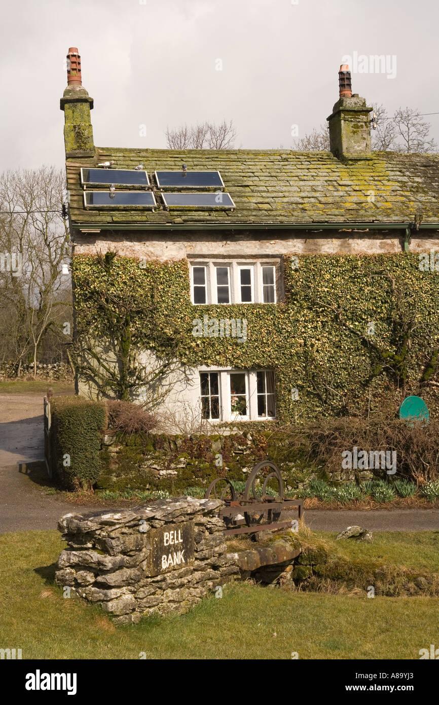 UK Yorkshire Wharfedale Threshfield Skirethorns traditional stone cottage with solar panels on roof Stock Photo