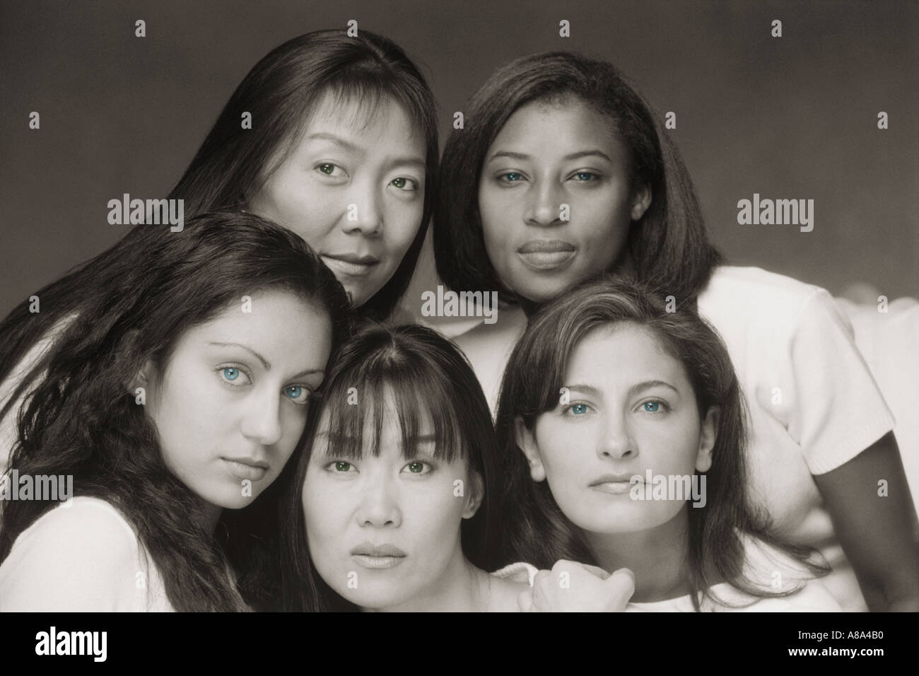 Five beautiful women and four different races - Stock Image