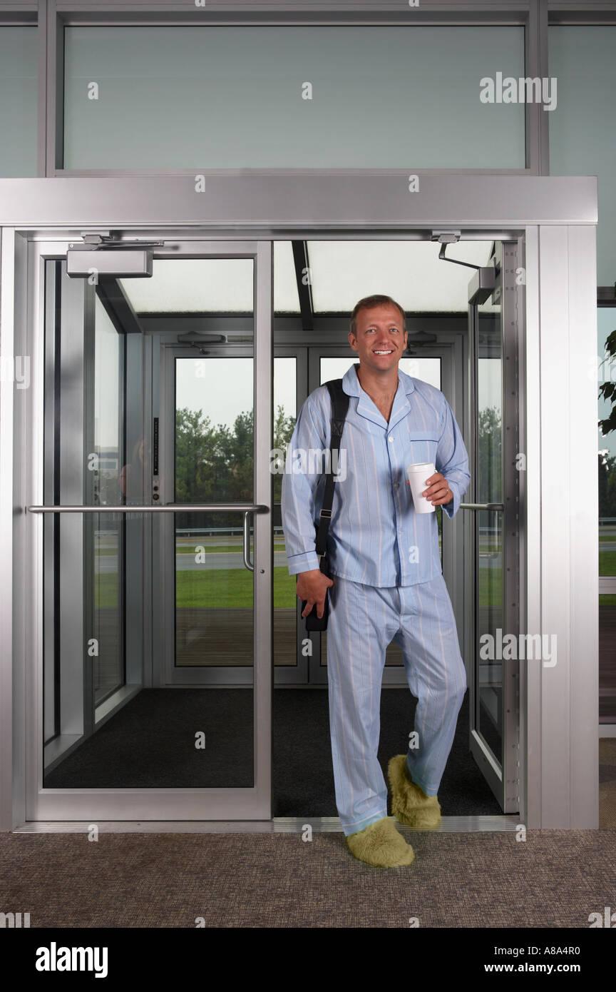 Businessman at work in his pajamas - Stock Image