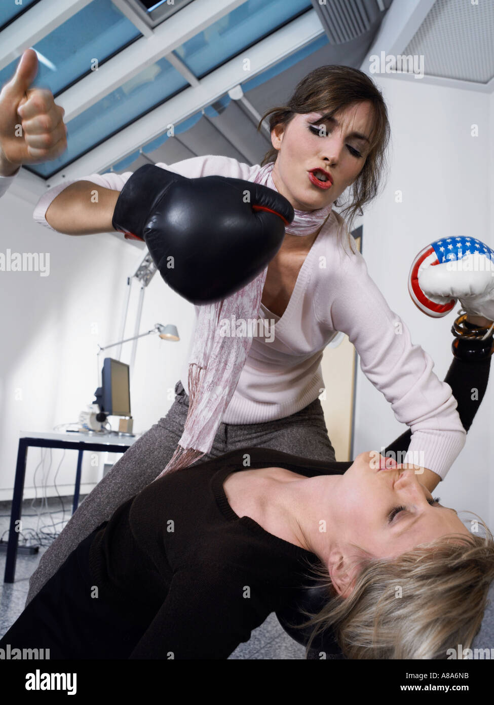 Female colleagues boxing - Stock Image