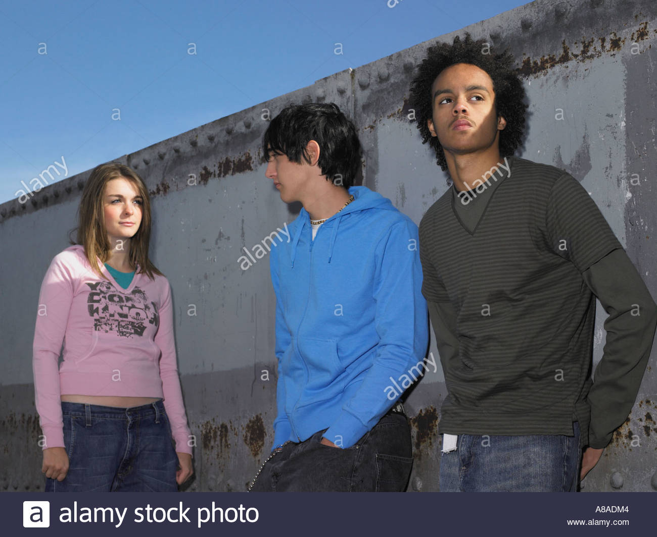 Three teenagers in urban location - Stock Image