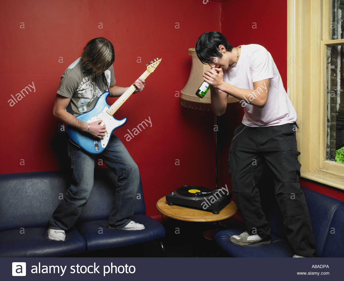Two friends playing guitar and singing - Stock Image