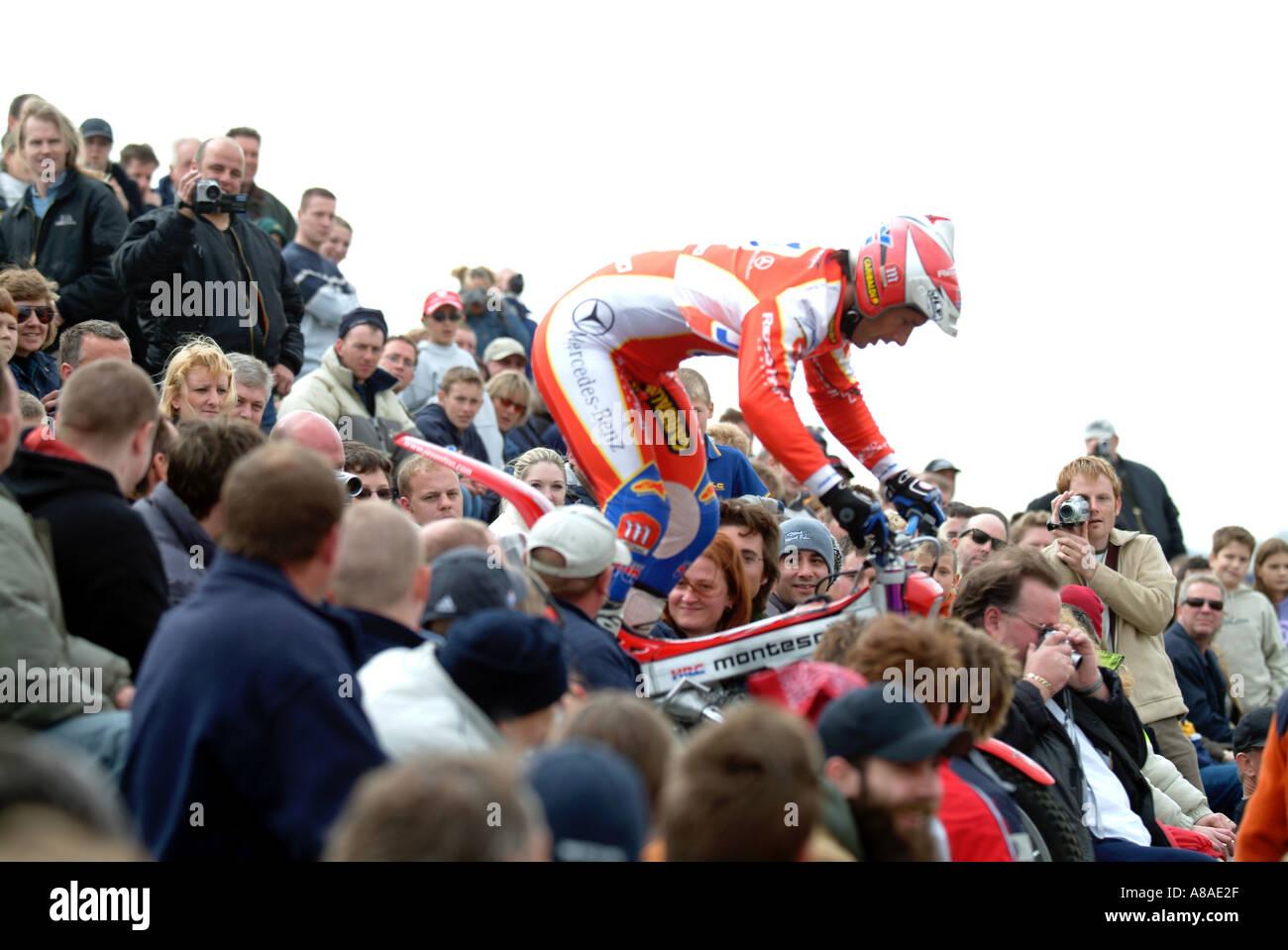 jason finn trials rider Adrenaline rush extreme risk danger motorbike tricks trick rider stuntman wheelie grandstand jump bunny - Stock Image