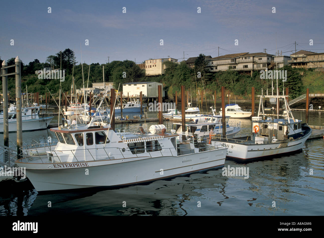 Commercial fishing boats docked in the world s smallest natural navigable harbor at Depoe Bay Oregon Coast Stock Photo