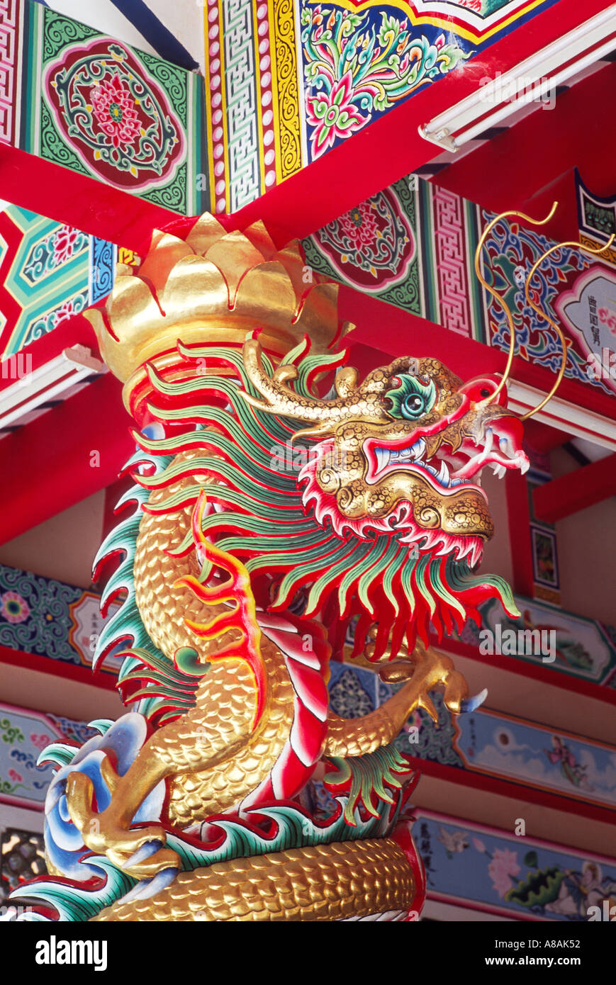 A temple dragon keeps watch over a temple - Stock Image