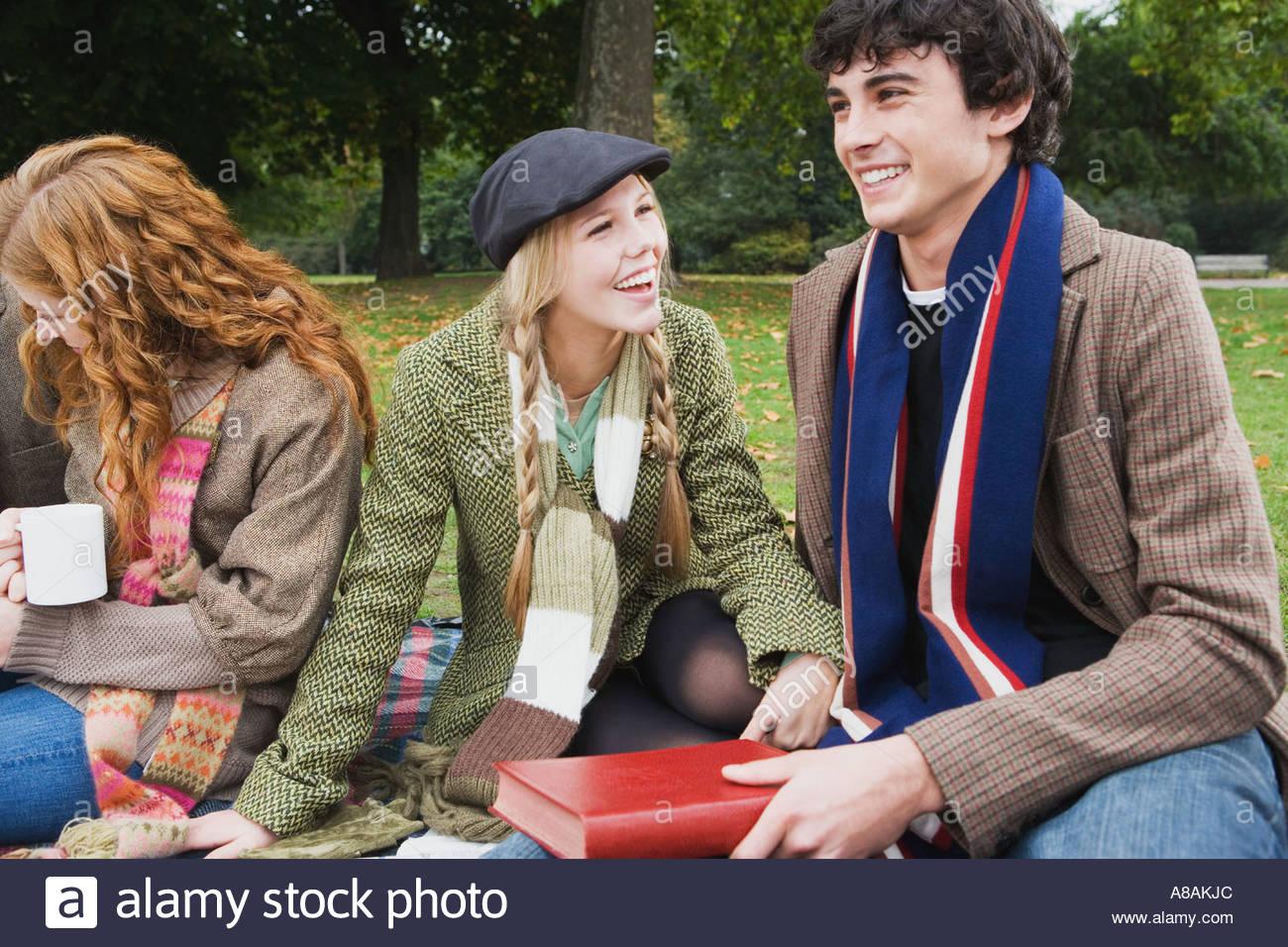 Three friends having picnic Stock Photo
