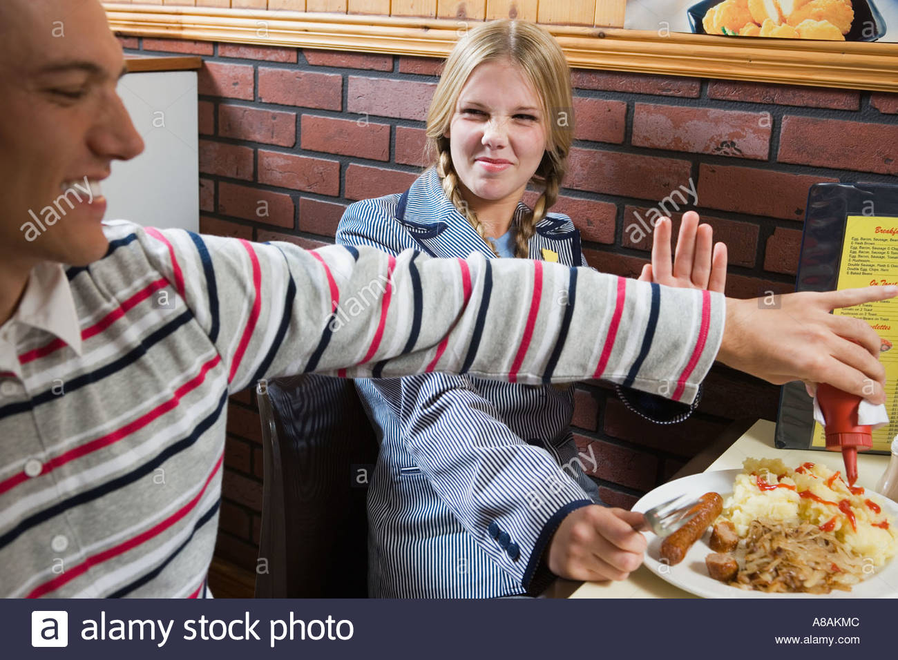 Couple eating in cafe - Stock Image