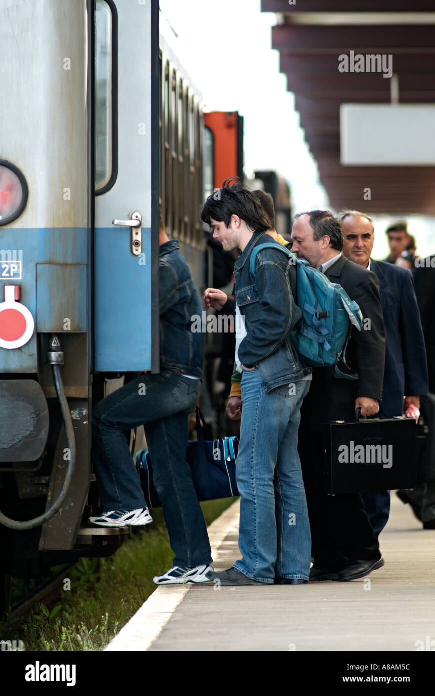 Passengers Boarding a Train Carriage - Stock Image