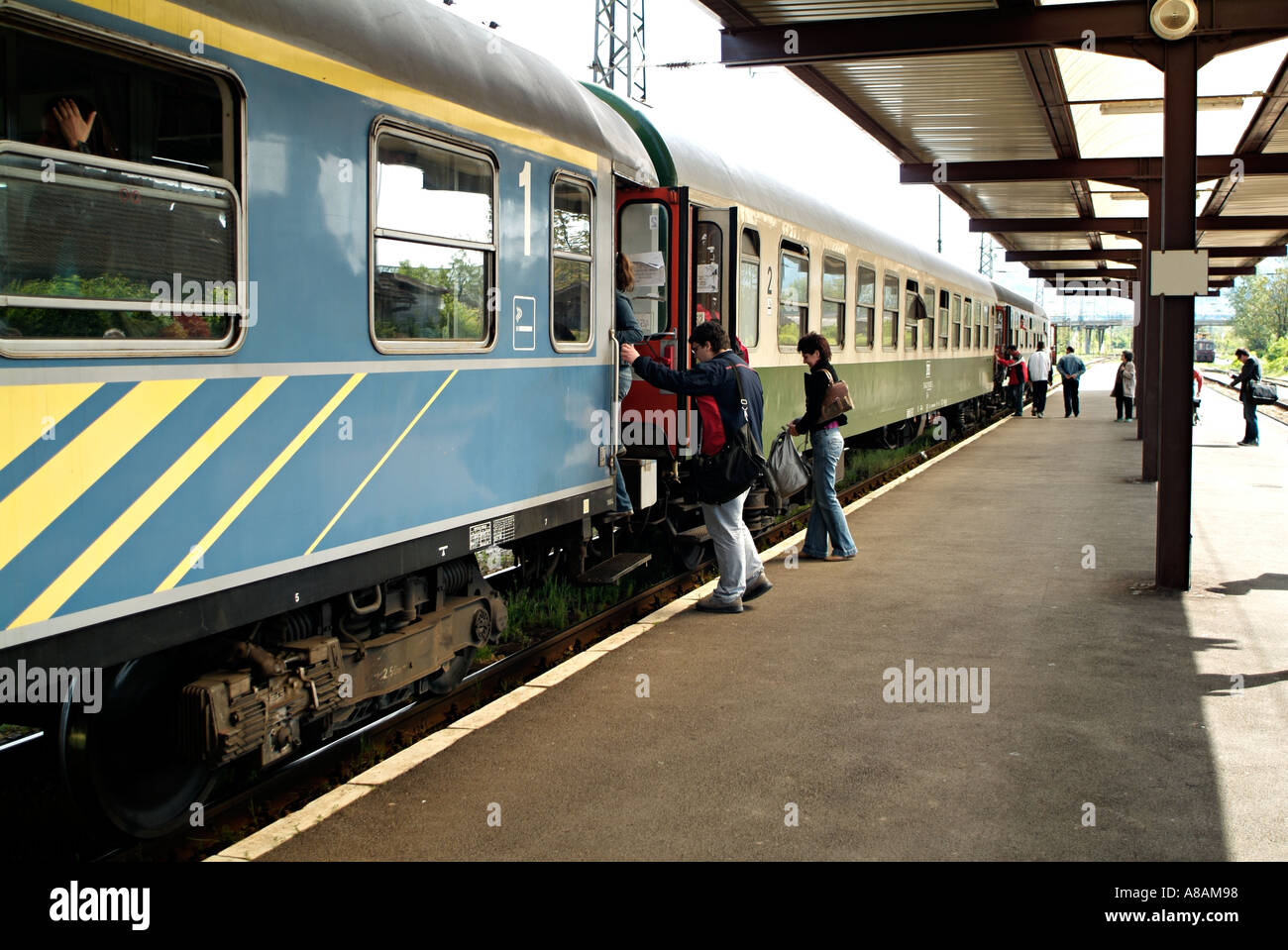 Passengers Boarding a Train Carriage at a Railway Station - Stock Image