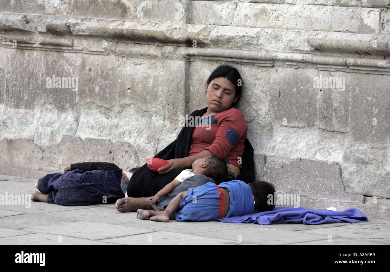 A destitute woman and her children asleep in a street of Oaxaca Mexico Stock Photo