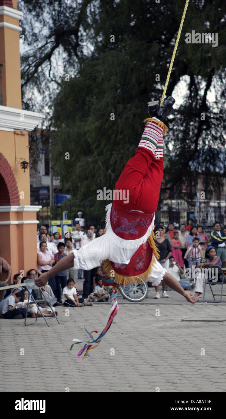 Los Voladores de Papantla a group performing traditional Mexican Indian ceremonies during a performance in Tule Mexico - Stock Image