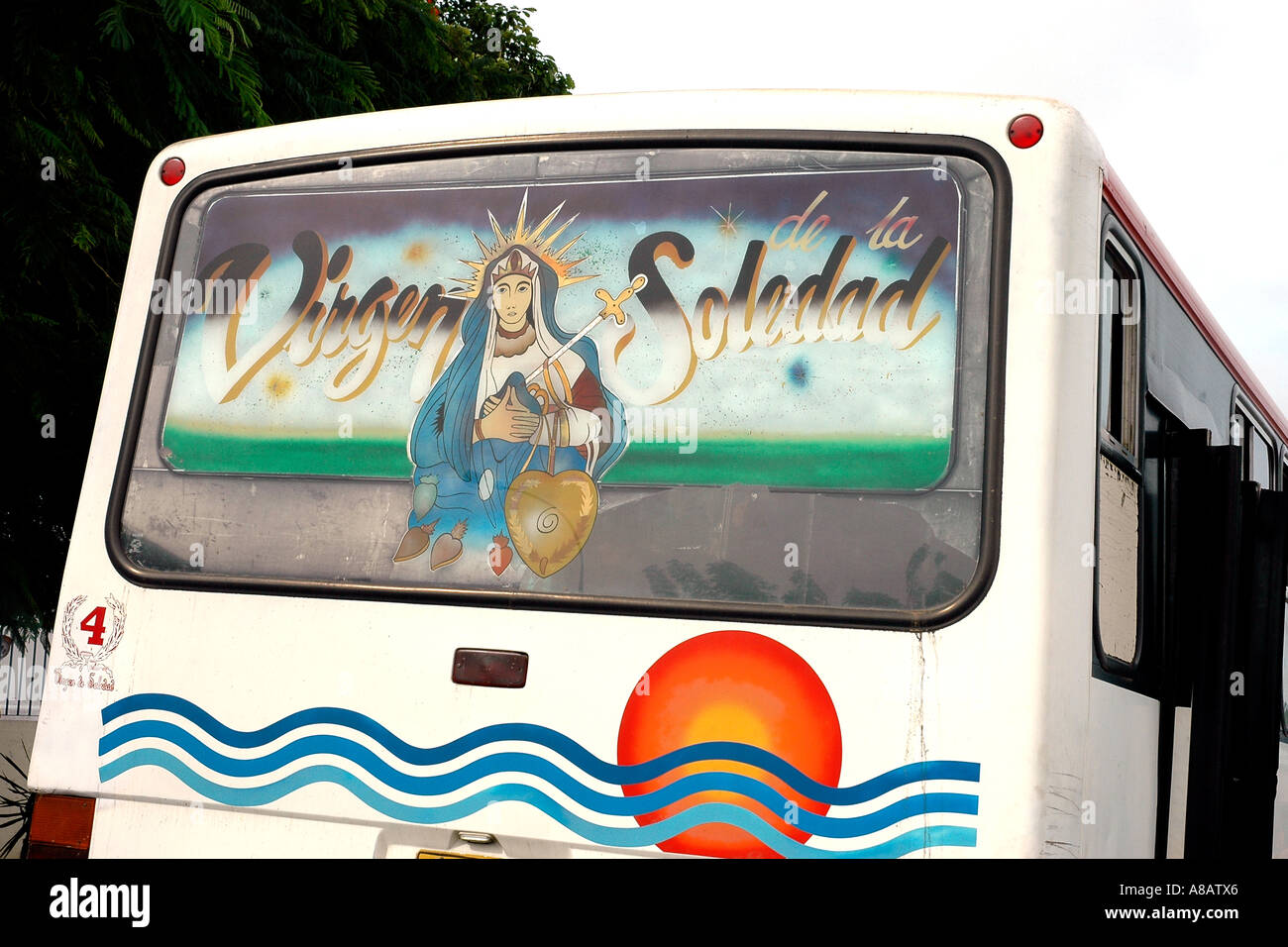 On the rear window of a bus in Ciudad Bolivar, Venezuela, an expression of faith - Stock Image
