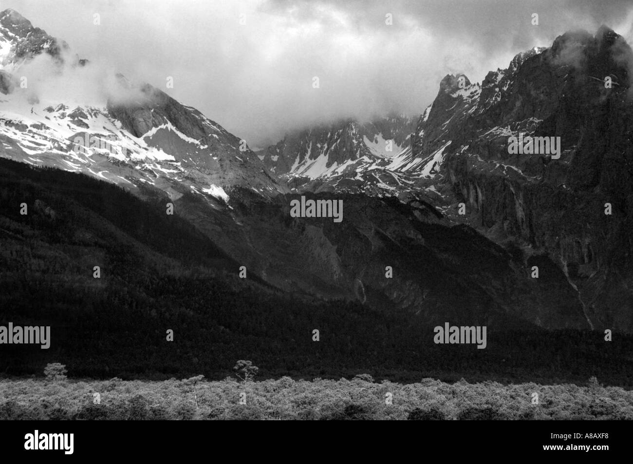 Yulong Snow Mountain, snow-capped mountains in Lijiang, China - Stock Image