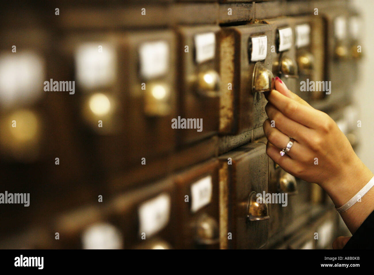 young woman opening a pharmacy shrine Stock Photo