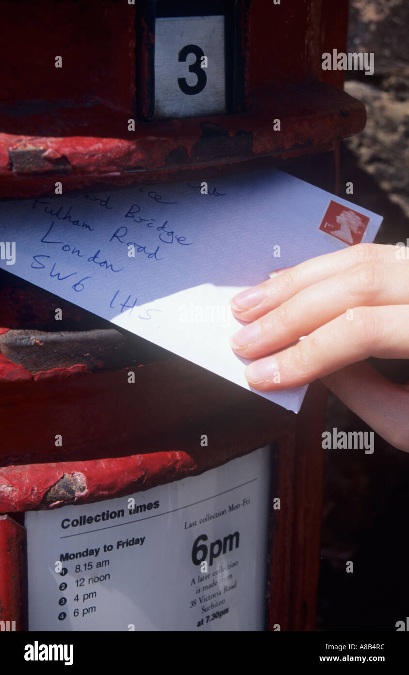 Posting a Letter in a Postbox, East Molesey, Surrey, England, UK - Stock Image