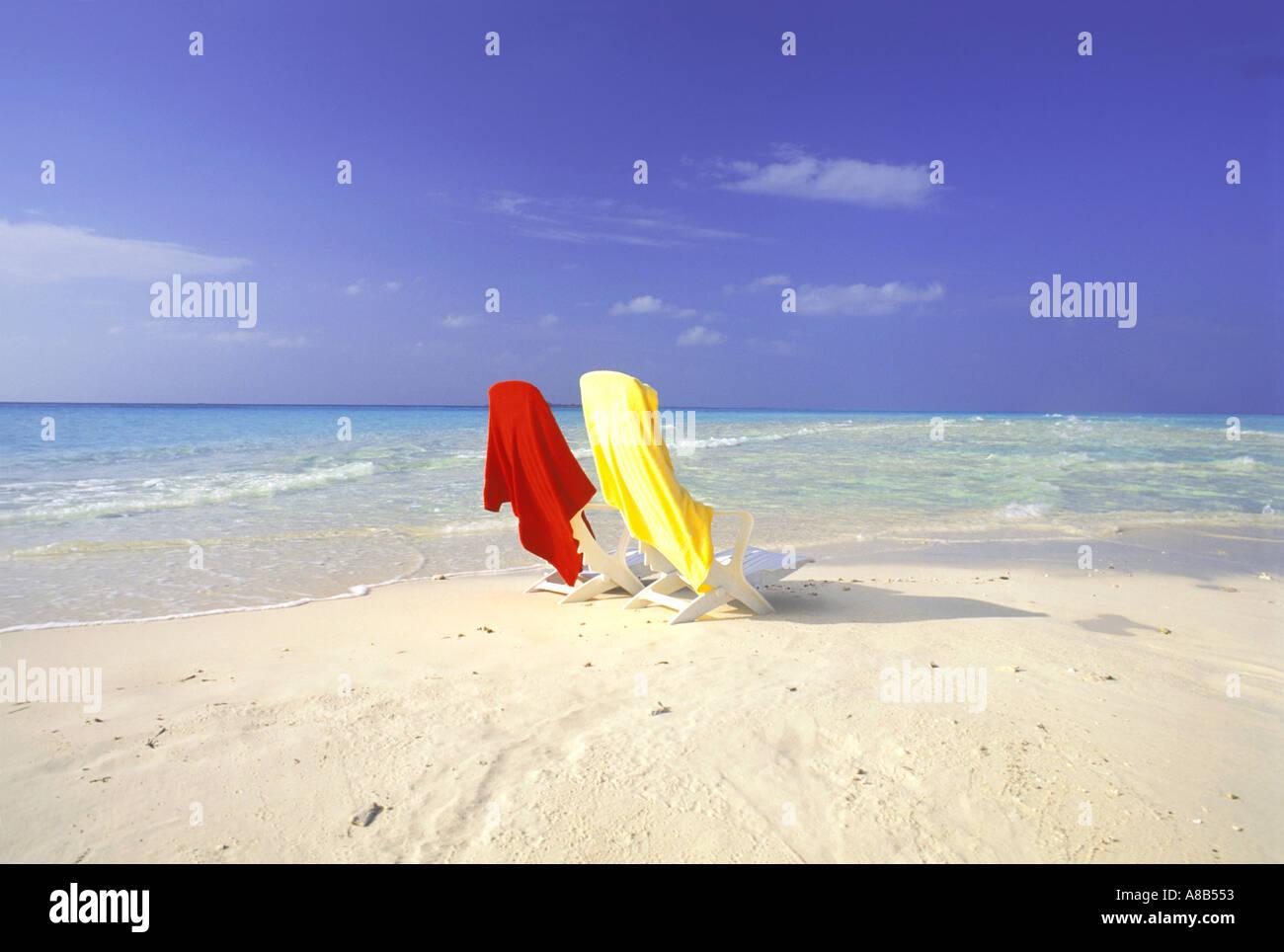 Awe Inspiring Maldive Islands Indian Ocean Beach Chairs With Towels Stock Machost Co Dining Chair Design Ideas Machostcouk