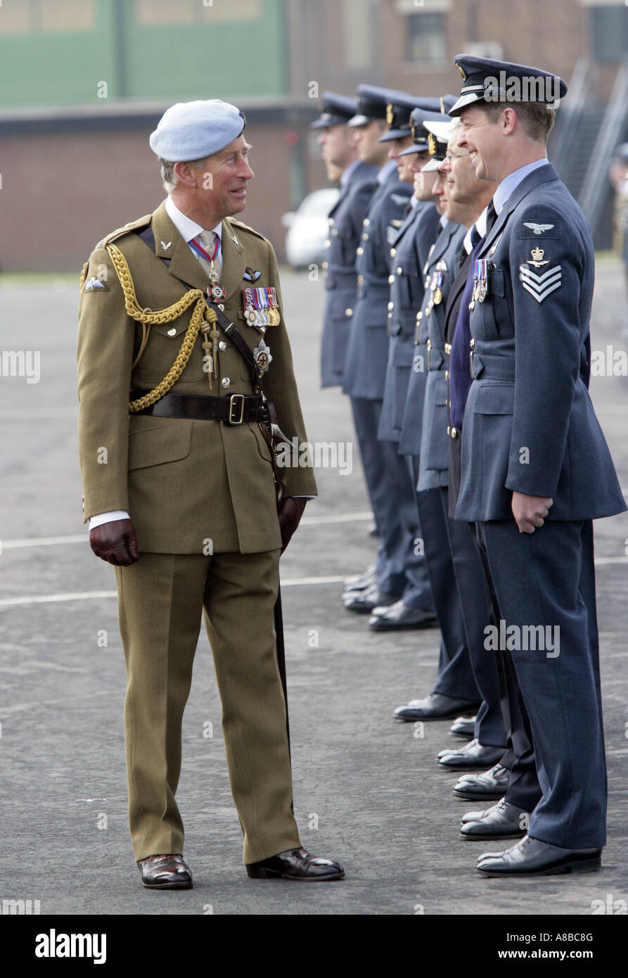 HRH Prince Charles, The Prince of Wales inspects officers at RAF Shawbury, the Helicopter Flying School - Stock Image