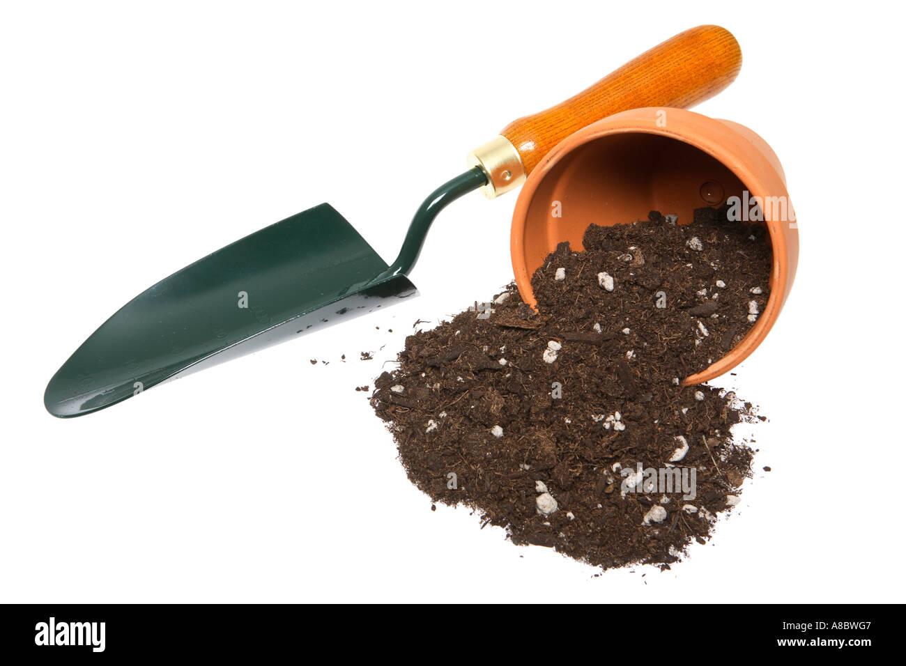 Potting Soil Garden Terra cotta pot with potting soil spilling out and garden shovel terra cotta pot with potting soil spilling out and garden shovel workwithnaturefo