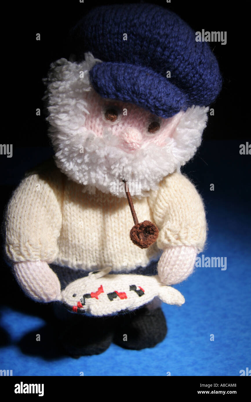 Studio shot of a knitted old sea dog bought at a car boot sale. - Stock Image
