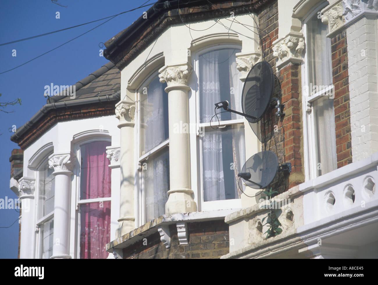 UK London Victorian Terraced Street North West London NW10 Satellite TV Dish - Stock Image