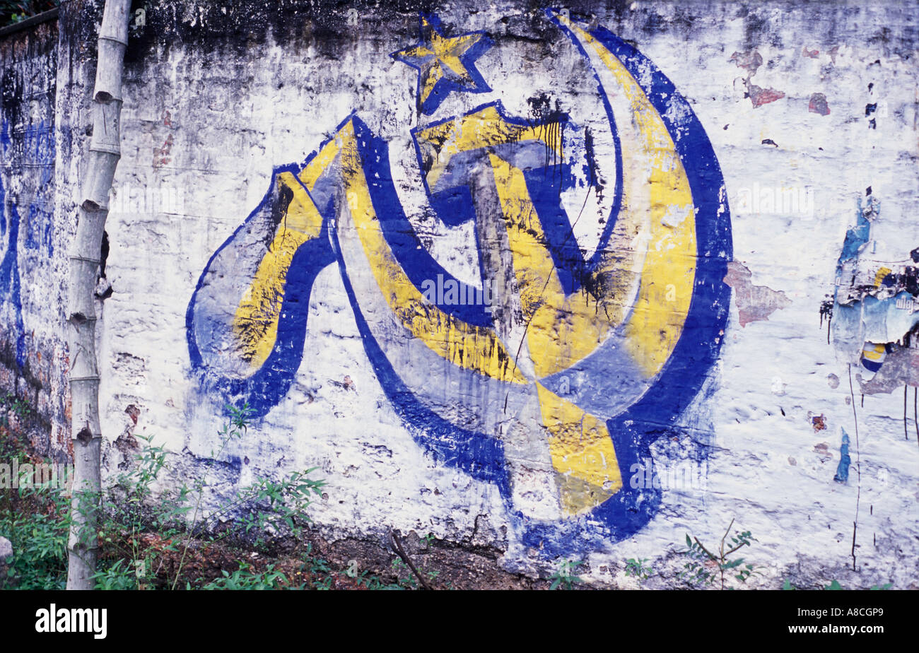 The Communist Symbol Of The Hammer And Sickle Painted On A Wall In