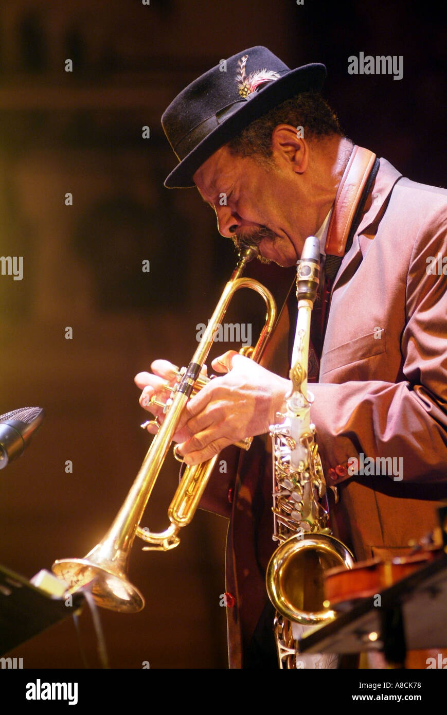Legendary jazz musician Ornette Coleman playing jazz trumpet and saxophone at Cheltenham Jazz Music Festival - Stock Image