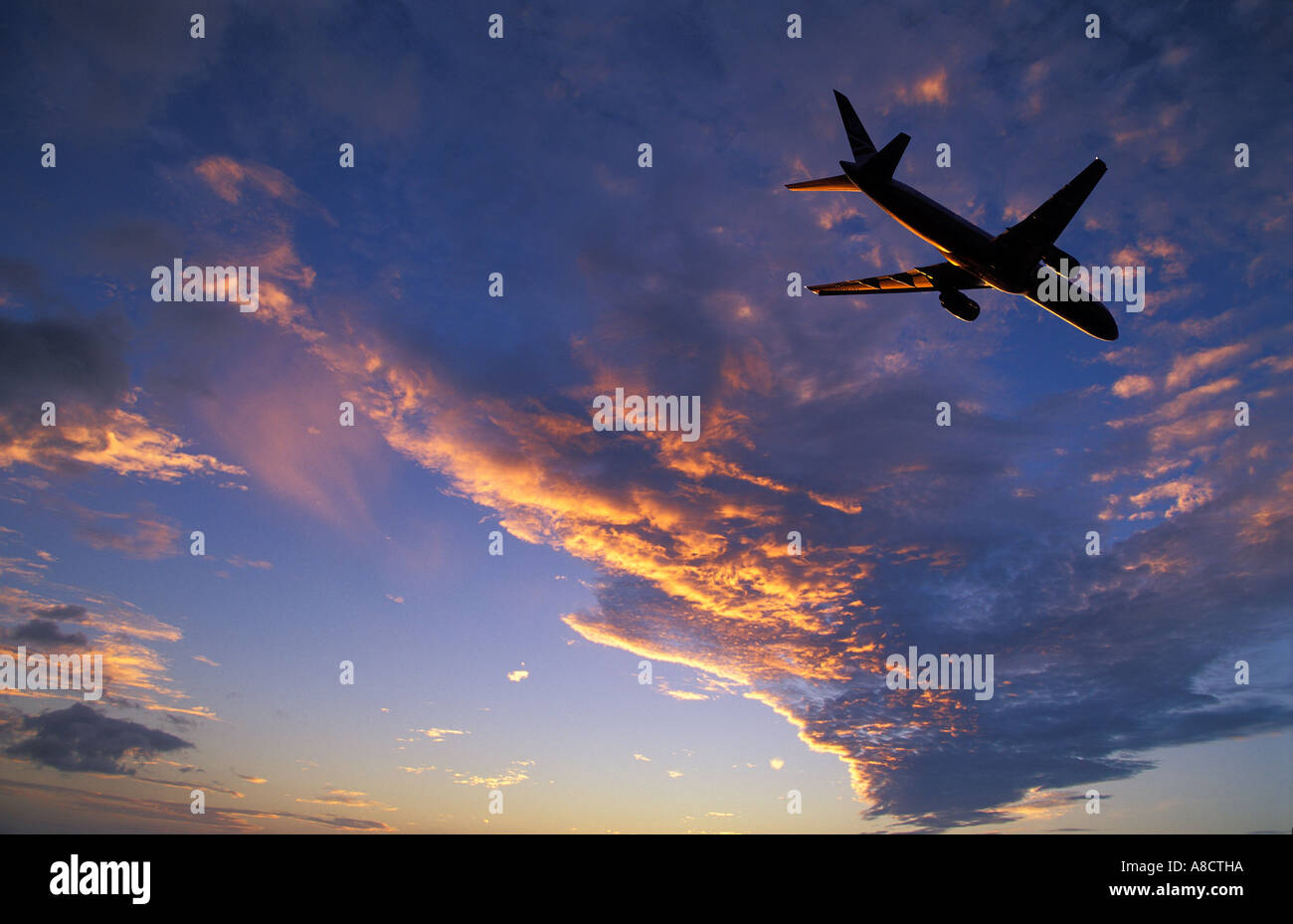 Plane in Flight London Heathrow Middlesex England UK - Stock Image