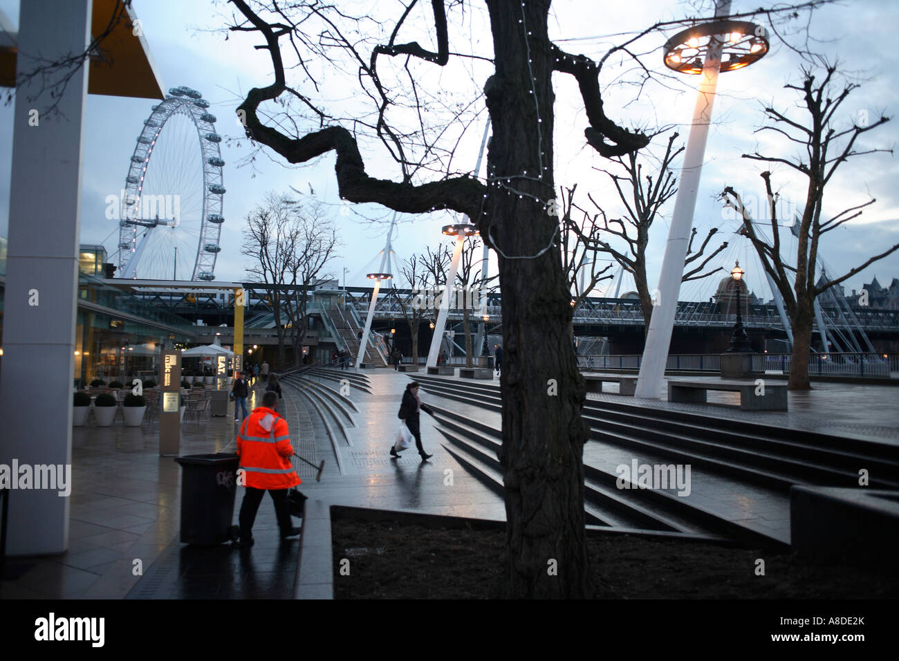 A street cleaner in his reflective jacket patrols the new pavements of the re-opened  southbank London Stock Photo