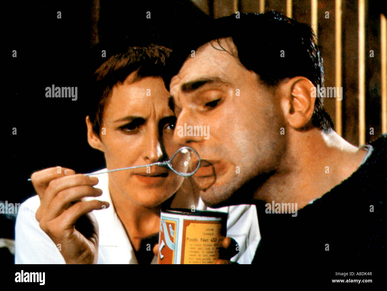 MY LEFT FOOT  - 1989 Palace film with Daniel-Day Lewis as Christy-Brown and Fiona Shaw as Dr Eileen Cole - Stock Image
