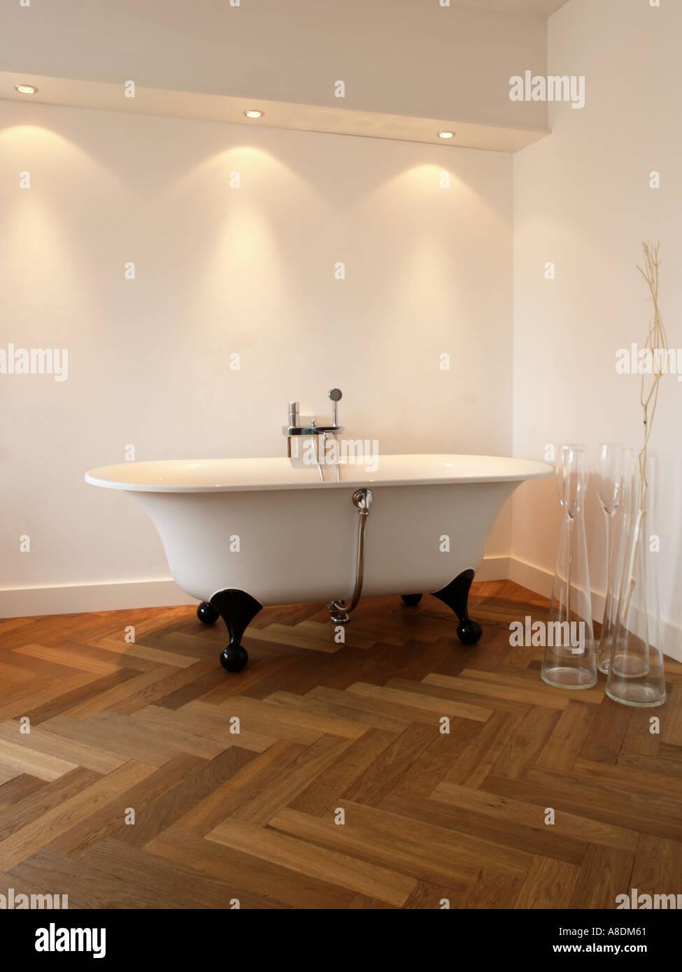 Designer Bathroom With Herringbone Parquet Halogen Lighting And Free  Standing Bath