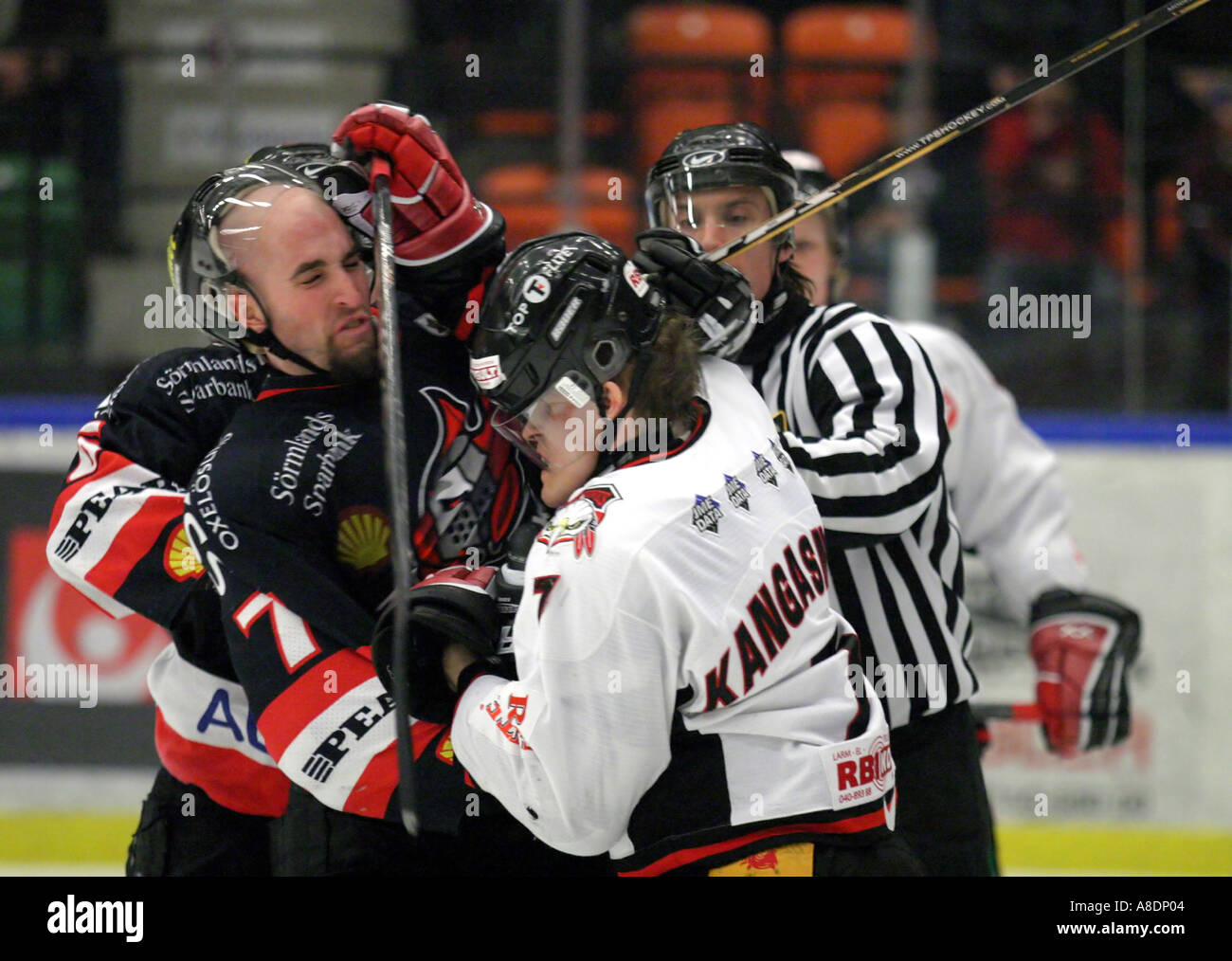Trent Hunter from Nykopings Hockey in a fight with Miska Kangasniemi from Malmo IF in Sweden 2005 - Stock Image