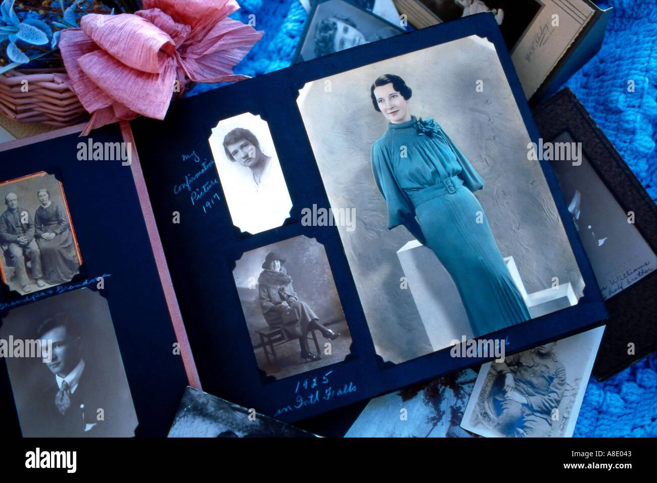 vintage photo album with hand tinted portrait - Stock Image