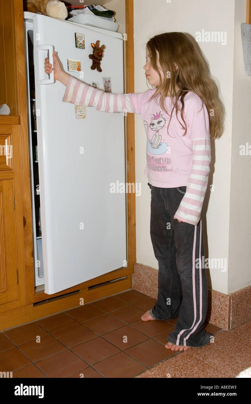 Young teenager shutting fridge door in kitchen - Stock Image & Shutting Door Stock Photos \u0026 Shutting Door Stock Images - Alamy