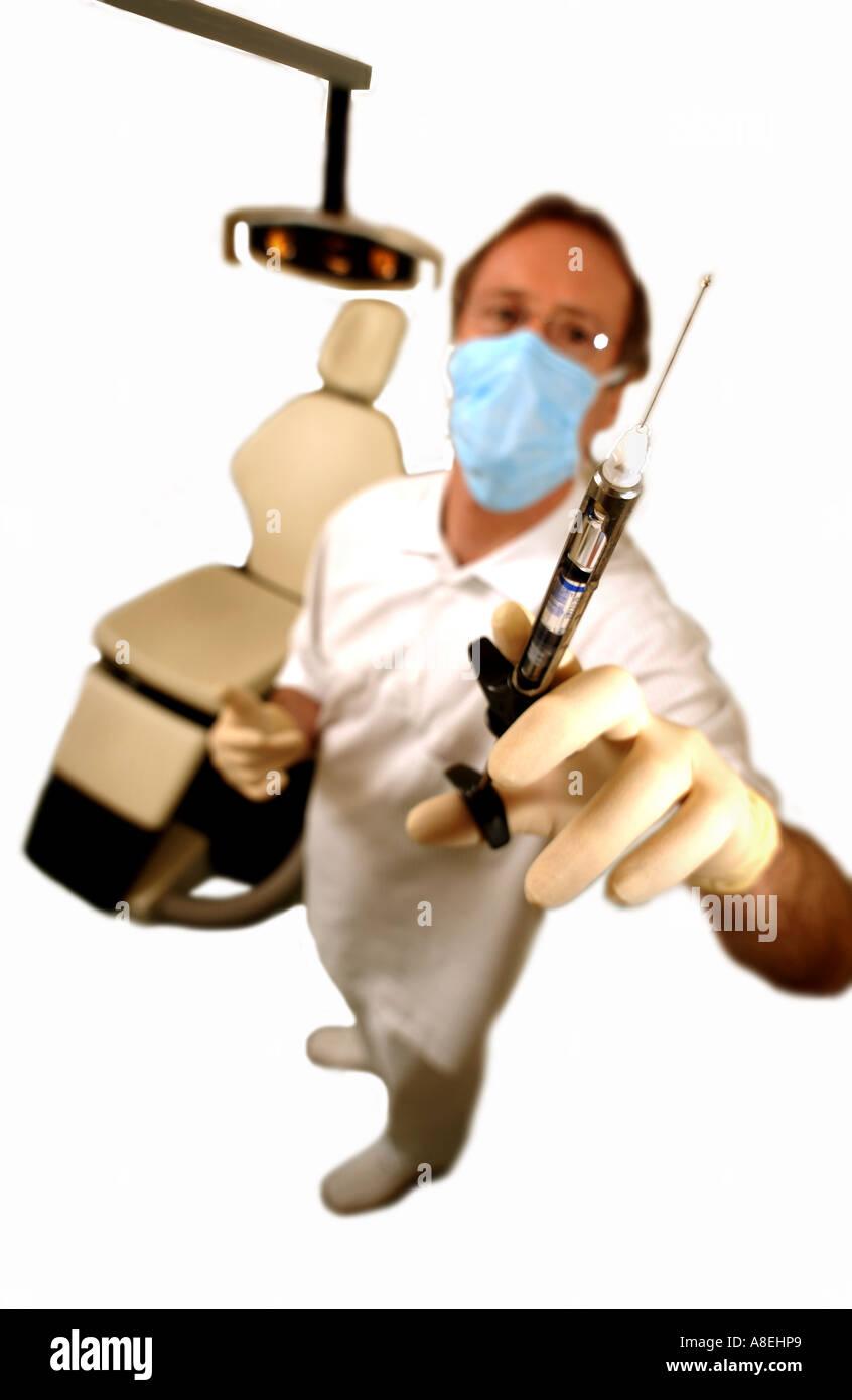 Dentist with syringe needle for anaesthetic - Stock Image