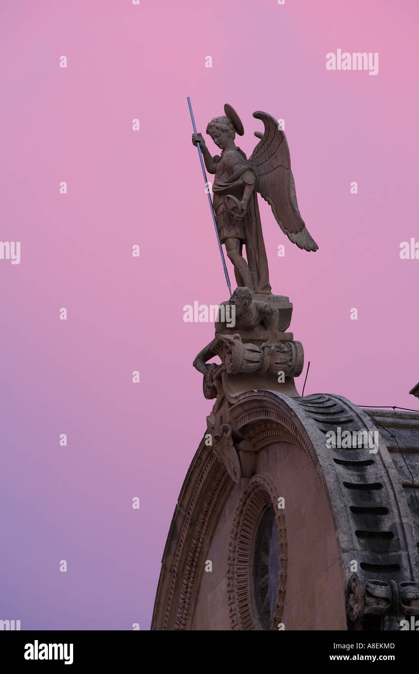 Statue of Archangel Michael, protector of Sibenik depicting battling devil with his spear, detail on St. James Cathedral - Stock Image
